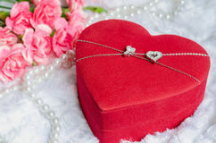 Red heart jewel gift box with pink carnation Royalty Free Stock Image