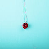 Red heart, jewelry. On wood background stock images