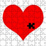 Red heart jigsaw puzzle Stock Photo