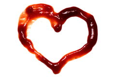 Red heart of ketchup. Isolated on white background Royalty Free Stock Image