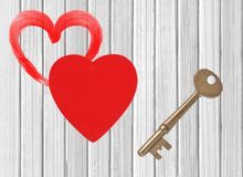 Red heart and key white wooden background Stock Image
