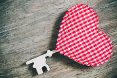 Red heart key on wooden for valentine background, vintage color. Tone Stock Photography