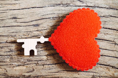 Red heart key on wooden for valentine background, vintage color. Tone Stock Photos