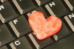 Red heart and keyboard. Red heart on the computer keyboard Royalty Free Stock Photo