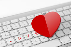 Red heart on keyboard. Love concept Stock Image
