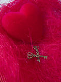 Red heart with keys on a red background Royalty Free Stock Photo