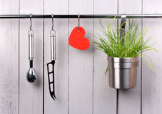 Red heart and kitchen cooking utensil on stainless Royalty Free Stock Photography