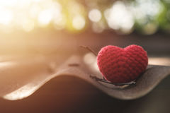 Red heart knitting on roof Royalty Free Stock Photography