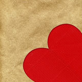 Red heart on the kraft paper Stock Image