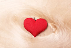 Red heart on a light wooden background Stock Photo