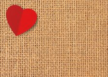 Red heart on linen texture Stock Images