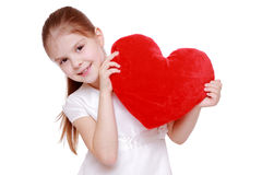 Red heart and little girl Royalty Free Stock Photography
