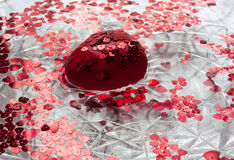 Red heart and little hearts floating in the water. A big red heart. Lots of little red hearts. They all float in water Royalty Free Stock Photography