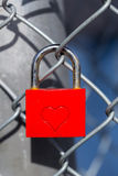 Red heart lock with a fence Royalty Free Stock Images