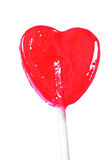 Red Heart Lollipop. Isolated red heart lollipop royalty free stock photos