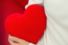 Red heart and love on hands - Valentine. Red heart and pure love of woman on hands - Valentine Royalty Free Stock Image