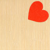 Red heart love symbol on beige bamboo mat valentines day Stock Images