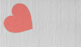 Red heart love symbol on grey gray bamboo mat valentines day Stock Photography