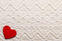 Red heart love symbol on lace background Stock Photos