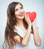 Red heart. Love symbol. Portrait of beautiful woman hold Valent Stock Image
