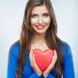 Red heart. Love symbol. Portrait of beautiful woman hold Valent Royalty Free Stock Images