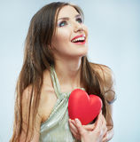 Red heart. Love symbol. Portrait of beautiful woman hold Valent Stock Photo