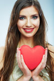 Red heart. Love symbol. Portrait of beautiful woman hold Valent Stock Photos