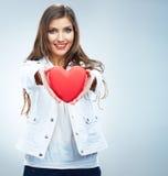 Red heart. Love symbol. Portrait of beautiful woman hold Valenti. Heart. Love symbol. Portrait of beautiful woman hold Valentine day symbol. Isolated studio stock photo