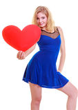 Red heart. Love symbol. Woman hold Valentine day symbol. Red heart. Love symbol. Portrait beautiful woman hold Valentine day symbol. Cute blonde girl in blue royalty free stock image