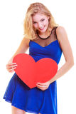 Red heart. Love symbol. Woman hold Valentine day symbol. Red heart card. Love symbol. Beautiful woman hold Valentine day symbol. Cute blonde girl in blue dress royalty free stock images