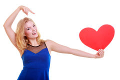 Red heart. Love symbol. Woman hold Valentine day symbol. Red heart card. Love symbol. Beautiful woman hold Valentine day symbol pointing. Cute blonde girl in royalty free stock images