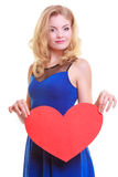 Red heart. Love symbol. Woman hold Valentine day symbol. Stock Image