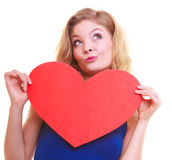 Red heart. Love symbol. Woman hold Valentine day symbol. Red heart card. Love symbol. Portrait beautiful woman hold Valentine day symbol. Cute blonde girl in stock image