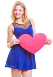 Red heart. Love symbol. Woman hold Valentine day symbol. Red heart card. Love symbol. Portrait beautiful woman hold Valentine day symbol. Cute blonde girl in royalty free stock image