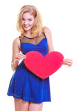 Red heart. Love symbol. Woman hold Valentine day symbol. Red heart card. Love symbol. Portrait beautiful woman hold Valentine day symbol. Cute blonde girl in royalty free stock photos