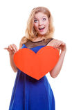 Red heart. Love symbol. Woman hold Valentine day symbol. Stock Photography