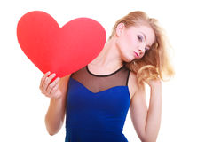Red heart. Love symbol. Woman hold Valentine day symbol. Red heart. Love symbol. Portrait beautiful woman hold Valentine day symbol. Cute blonde girl in blue stock photography