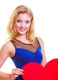 Red heart. Love symbol. Woman hold Valentine day symbol. Red heart. Love symbol. Portrait beautiful woman hold Valentine day symbol. Cute blonde girl in blue royalty free stock photography