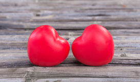 Red heart in love of Valentine's day with wood background. Stock Image