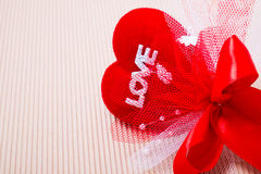 Red heart with love word and ribbon. Red heart with love word  decorate with ribbon on paper Royalty Free Stock Photography