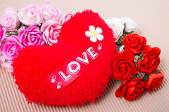 Red heart with love word and roses. Red heart with love word  decorate with roses on paper Royalty Free Stock Image