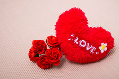 Red heart with love word and roses. Red heart with love word  decorate with roses on paper Royalty Free Stock Photos