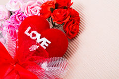 Red heart with love word and roses. Red heart with love word  decorate with ribbon and roses on paper Stock Photography