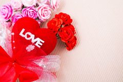 Red heart with love word and roses. Red heart with love word  decorate with ribbon and roses on paper Royalty Free Stock Photos