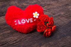 Red heart with love word and roses. Red heart with love word  decorate with roses on wooden table top Stock Image