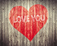 Red Heart and Love You sentence on wooden background. Romantic symbol painted  Royalty Free Stock Image
