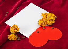 Red heart lying on an envelope with dried roses and coffee beans Royalty Free Stock Photography