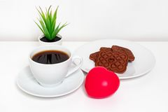 Red heart lying on white table near a cup of coffee and cookies, spring and valentine`s day concept royalty free stock photos