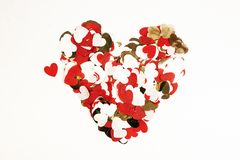 Red heart made of confetti on white background. Flat lay, top view. Valentine s day composition stock image