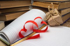 Red heart made of paper and notebook Stock Photo